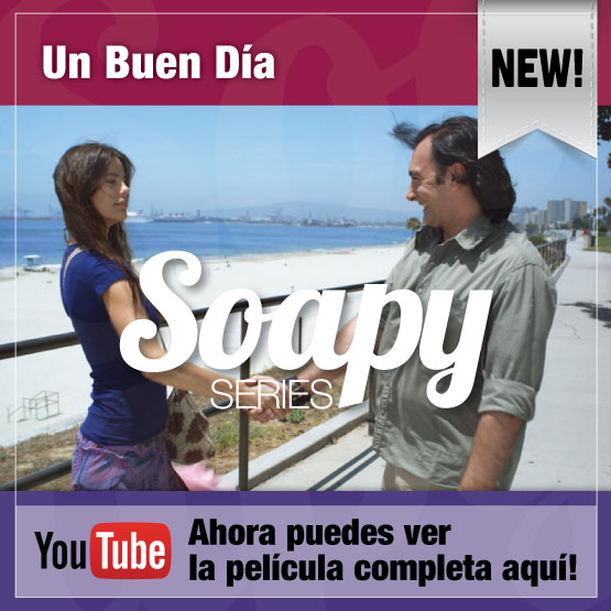 youtube ad of a male and female actors shaking hands by a beach sidewalk, scene of a Spanish movie